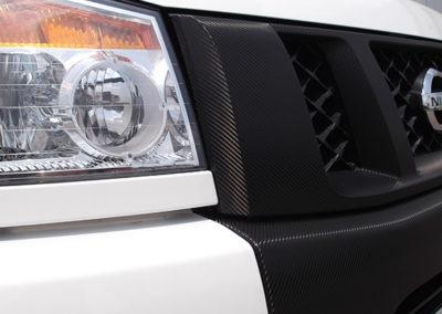AGWraps-Wraps-Specialty-Films-Nissan Dinoc Vinyl Carbon Fiber Grill Closeup